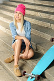 Pleasant girl sitting on the footsteps Royalty Free Stock Photography
