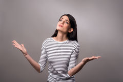 Pleasant girl standing isolated on grey background Royalty Free Stock Photography