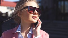 Pleasant girl in sunglasses with fashion look outdoor stock video
