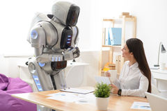 Pleasant girl talking with robot Royalty Free Stock Image