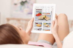 Pleasant girl using tablet Royalty Free Stock Photos