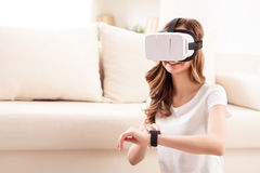 Pleasant girl wearing virtual reality device royalty free stock image