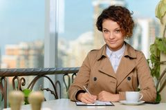 Pleasant girl writing Royalty Free Stock Photography
