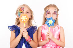 Pleasant girls holding paper flowers Royalty Free Stock Photo