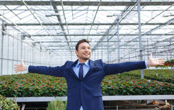 Pleasant greenhouse owner controlling his business Royalty Free Stock Photos