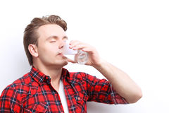 Pleasant guy drinking water Royalty Free Stock Photo