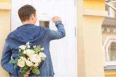 Pleasant guy holding flowers Royalty Free Stock Photos