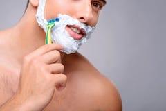 Pleasant guy shaving Stock Photo