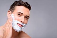 Pleasant guy shaving Stock Photography