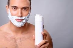 Pleasant guy shaving Royalty Free Stock Photos