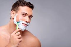 Pleasant guy shaving Stock Photos