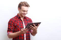 Pleasant guy surfing through the Internet Stock Photo