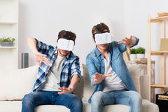Pleasant guys using virtual reality device Stock Images