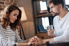 Pleasant handsome man looking at his girlfriend stock photo
