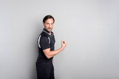 Pleasant handsome man showing his strength. Stock Image