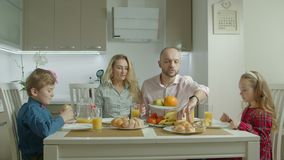Pleasant happy family having morning meal together stock video