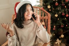 Pleasant happy woman talking on the phone stock image