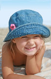 Pleasant holiday. Child is going a brown on the sea beach Stock Photography