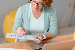 Pleasant involved woman working at home Royalty Free Stock Photo