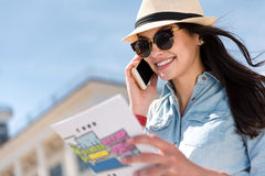 Pleasant joyful woman talking on cell phone Stock Images