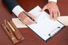 Pleasant lawyer signing papers Royalty Free Stock Images