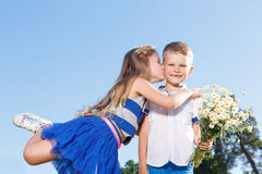 Pleasant little boy and girl kissing Stock Photos
