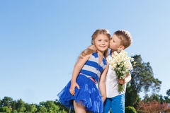 Pleasant little boy and girl kissing Royalty Free Stock Images