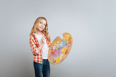 Pleasant little gilr holding color palette Royalty Free Stock Photography