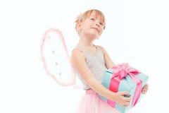 Pleasant little girl holding present Stock Photo