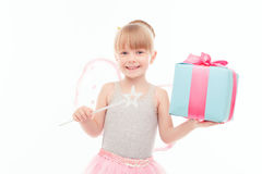 Pleasant little girl holding present Royalty Free Stock Photo