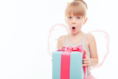 Pleasant little girl holding present Royalty Free Stock Image
