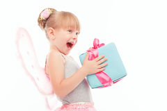 Pleasant little girl holding present Stock Photography