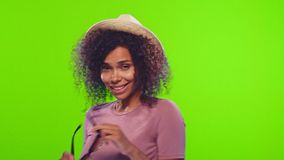 Black woman wears straw hat and sunglasses, invites to join vacation, chroma key