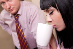 Pleasant looking brunette drinking coffee Stock Photo