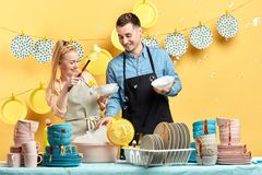 Pleasant lovely woman and man enjoying time in the kitchen stock photos