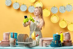 Pleasant lovely young fair-haired woman sending sms, message, royalty free stock photos