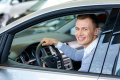 Pleasant man choosing car in auto show Royalty Free Stock Photography