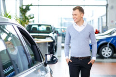 Pleasant man choosing car in auto show Royalty Free Stock Image