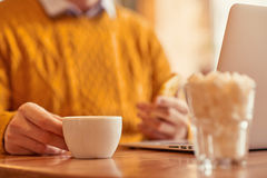 Pleasant man  drinking coffee Royalty Free Stock Images