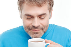 Pleasant man drinking tea Royalty Free Stock Image