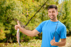 Pleasant man fishing Royalty Free Stock Photo
