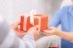 Pleasant man giving present Royalty Free Stock Image