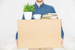 Pleasant man holding the box Royalty Free Stock Images