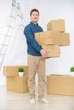 Pleasant man holding boxes Royalty Free Stock Photos