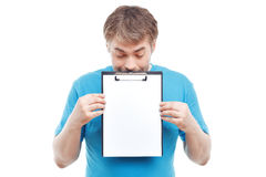 Pleasant man holding folder Royalty Free Stock Photo