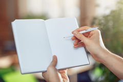 Pleasant man making notes Stock Images