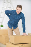 Pleasant man packing the boxes Royalty Free Stock Photos