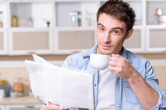 Pleasant man reading newspaper Stock Image