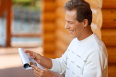 Pleasant man reading newspaper Royalty Free Stock Photography