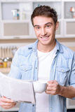 Pleasant man reading newspaper Stock Photography